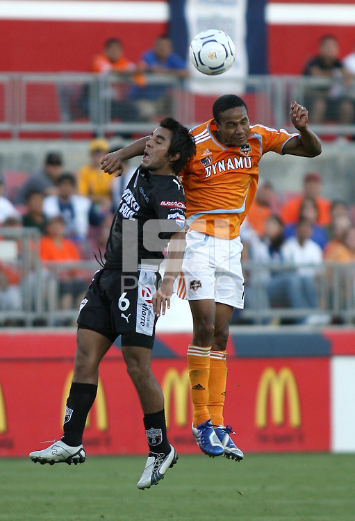 FC Pachuca midfielder Jaime Correa (6) and Houston Dynamo midfielder Ricardo Clark (13) go up for the header.   Houston Dynamo beat FC Pachuca 2-0 at Robertson Stadium in Houston, TX on March 15, 2007 in the first of a two game series in the CONCACAF Champions' Cup semi-finals.