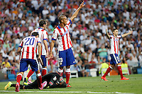 Juanfran, Miranda and Moya of Atletico de Madrid during La Liga match between Real Madrid and Atletico de Madrid at Santiago Bernabeu stadium in Madrid, Spain. September 13, 2014. (ALTERPHOTOS/Caro Marin)