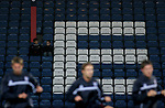 Blackburn Rovers 3, Huddersfield Town 1, 22/09/2005. Ewood Park, Carling Cup. Two Rovers fans disinterested in the Huddersfield Town pre-match warm-up. Photo by Colin McPherson.