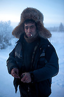 A portrait of a fisherman smoking a cigarette in Tomtor, one of the coldest inhabited places on earth having recorded some of the lowest temperatures.
