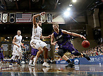 SIOUX FALLS, SD - FEBRUARY 27:  Jordan Stotts #44 from the University of Sioux Falls looks to drive against Casey Schilling #32 from Augustana during their NSIC Tournament game Saturday night at the Pentagon in Sioux Falls. (Photo by Dave Eggen/Inertia)