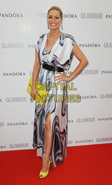 Tess Daly.Women Of The Year 2012 - Glamour Awards, Berkeley Square, London, England..29th May 2012.full length white black grey gray print dress slit split yellow shoes clutch bag hand on hip.CAP/WIZ.© Wizard/Capital Pictures.