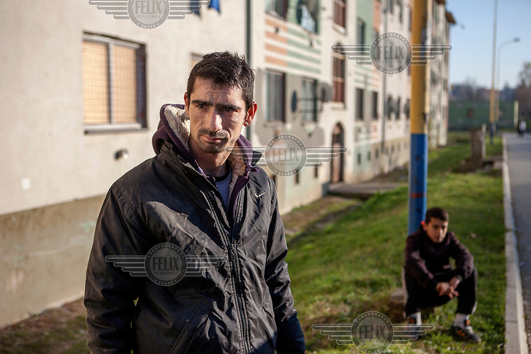 A man and a boy outside an apartment block in the district of Stara Tehelna. This suburb is a segregated district populated by Roma who were moved en mass out of the city centre in 2001.