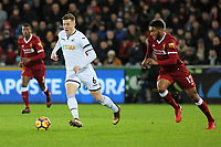 (L-R) Alfie Mawson of Swansea City chased by Joe Gomez of Liverpool during the Premier League match between Swansea City and Liverpool at The Liberty Stadium, Swansea, Wales, UK. Monday 22 January 2018