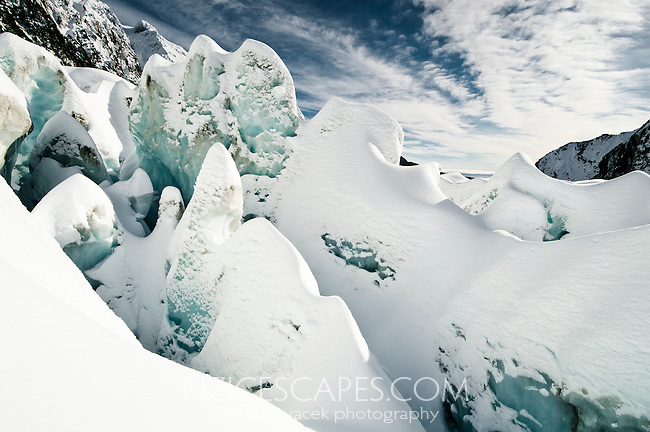 Beautiful shapes of deep, freshly snowed up crevasses on Franz Josef Glacier, Westland National Park, West Coast, New Zealand
