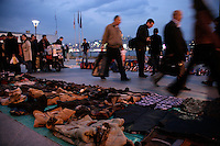 Illegal evening market at the quayside at Eminonu, Istanbul, Turkey