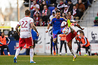 Vicente Sanchez (7) of the Colorado Rapids and Roy Miller (7) of the New York Red Bulls go for the ball. The New York Red Bulls and the Colorado Rapids played to a 1-1 tie during a Major League Soccer (MLS) match at Red Bull Arena in Harrison, NJ, on March 15, 2014.