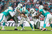 04.10.2015. Wembley Stadium, London, England. NFL International Series. Miami Dolphins versus New York Jets. Miami Dolphins Quarterback Ryan Tannehill is tackled by New York Jets Defensive End Stephen Bowen and New York Jets Defensive End Leonard Williams before he can throw the ball.