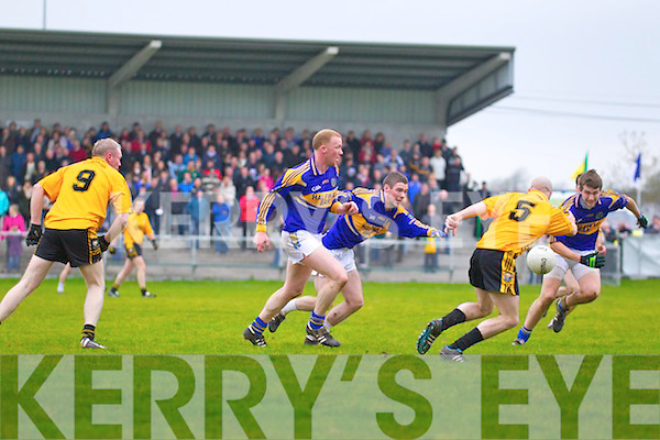 Ger McCarthy of Listowel Emmets races for the loose ball against Brendan Whelan, Paudie Whelan and Brendan O'Connell of St Senans during last Sunday's Bernard O'Callaghan Memorial Championship quater final in Con Brosnan Park, Moyvane.