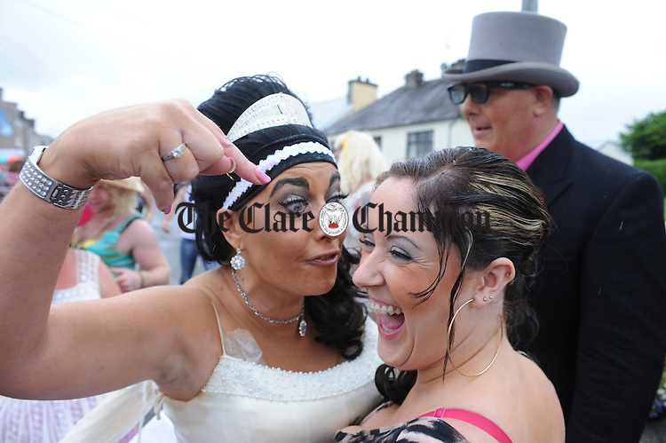 Sharon Murray,  has some colourful words with Eva Dempsey during the Kimihil Festival parade. Photograph by Declan Monaghan
