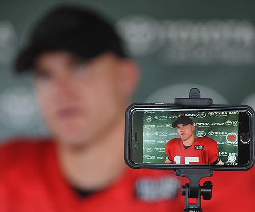 The LCD of a mobile phone shows Josh McCown #15, New York Jets Quarterback, as he speaks with the media after team practice at the Atlantic Health Jets Training Center in Florham Park, NJ on Sunday, July 29, 2018.