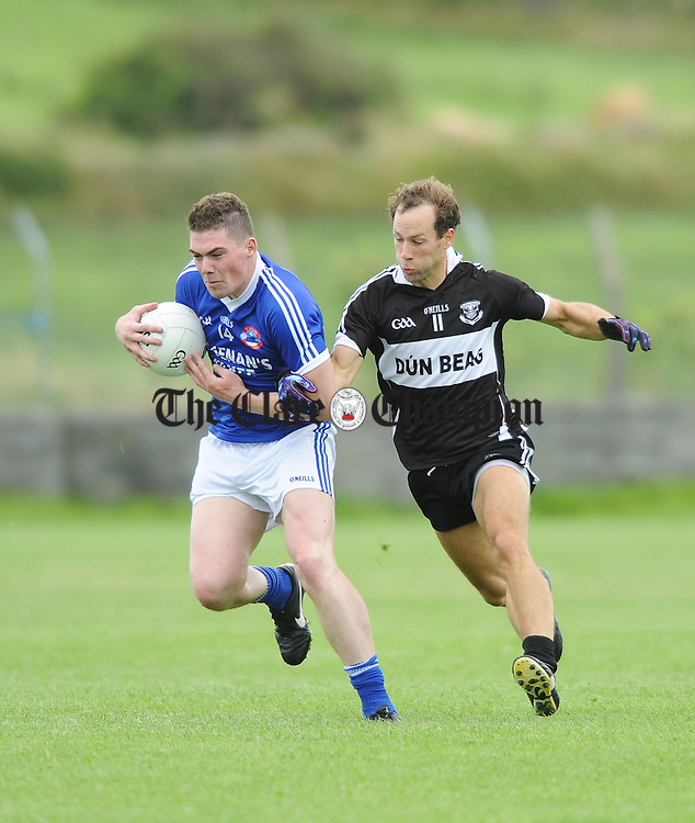 Chris Williamson of Kilkee in action against Ronan Goode of Doonbeg during their game at Quilty. Photograph by John Kelly.