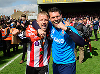 Lincoln City's Terry Hawkridge, left, and Lincoln City's goalkeeping coach Jimmy Walker celebrate at the end of the game<br /> <br /> Photographer Chris Vaughan/CameraSport<br /> <br /> Vanarama National League - Lincoln City v Macclesfield Town - Saturday 22nd April 2017 - Sincil Bank - Lincoln<br /> <br /> World Copyright &copy; 2017 CameraSport. All rights reserved. 43 Linden Ave. Countesthorpe. Leicester. England. LE8 5PG - Tel: +44 (0) 116 277 4147 - admin@camerasport.com - www.camerasport.com