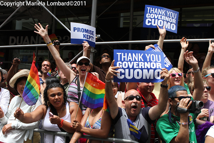 .Gov. Andrew Cuomo, Mayor Bloomberg and Speaker Christine Quinn march at the gay pride parade along Fifth Ave. in Manhattan..