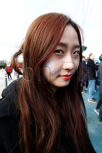 14.02.2016. The Etihad, Manchester, England. Barclays Premier League. Manchester City versus Tottenham Hotspur. A young Japanese fan face painted with the City logo.