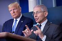 Director of the National Institute of Allergy and Infectious Diseases at the National Institutes of Health Dr. Anthony Fauci, joined by United States President Donald J. Trump and members of the Coronavirus Task Force, makes remarks on the Coronavirus crisis in the Brady Press Briefing Room of the White House in Washington, DC on Saturday, March 21, 2020.  Credit: Stefani Reynolds / Pool via CNP Credit: Stefani Reynolds / Pool via CNP/AdMedia