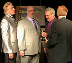 Lindenhurst, New York, USA. September 23, 2018. Magicians (L-R) RJ LEWIS, JOE SILKIE, BOB YORBURG, and DAVID ROSENFELD pose after performing in Comedy Magic Show presented by The Parlor of Mystery and South Shore Theatre Experience. ProducerMIKE MAIONE is seen from back, Bob Yorburg, AKA Professor Phineas Feelgood, is a master wood carver and used unusual props in show. RJ Lewis, who sang song at start of his magic set, appeared in Broadway musical 'Barnum.' David Rosenfeld performed close-up magic and mentalism. Joe Silkie, the Parlor of Mystery Producer, hosted show, and constructed and used custom magic props.