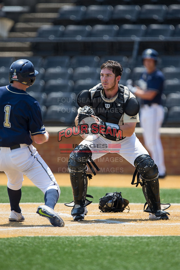 Wake Forest Demon Deacons catcher Ben Breazeale (39) prepares to put the tag on Nico Popa (1) of the Pittsburgh Panthers at David F. Couch Ballpark on May 20, 2017 in Winston-Salem, North Carolina. The Demon Deacons defeated the Panthers 14-4.  (Brian Westerholt/Four Seam Images)