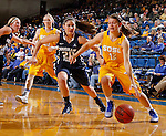 BROOKINGS, SD - NOVEMBER 14:  Macy Miller #12 from South Dakota State University drives past Cassie Broadhead #20 from Brigham Young in the first half of their game Friday night at Frost Arena.  (Photo by Dave Eggen/Inertia)