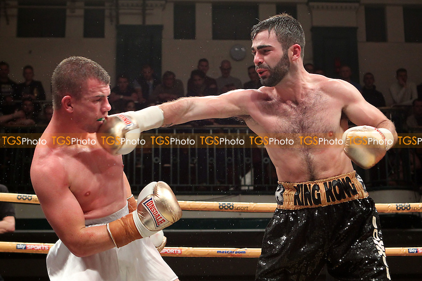 Jono Carroll (black shorts) defeats Gary Buckland in a Prizefighter The Lightweights boxing SF contest, promoted by Matchroom Sports - 06/12/14 - MANDATORY CREDIT: Gavin Ellis/TGSPHOTO - Self billing applies where appropriate - contact@tgsphoto.co.uk - NO UNPAID USE