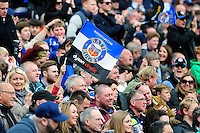 A general view of a Bath Rugby fan in the crowd waving a flag in support. Aviva Premiership match, between Bath Rugby and Sale Sharks on April 23, 2016 at the Recreation Ground in Bath, England. Photo by: Patrick Khachfe / Onside Images