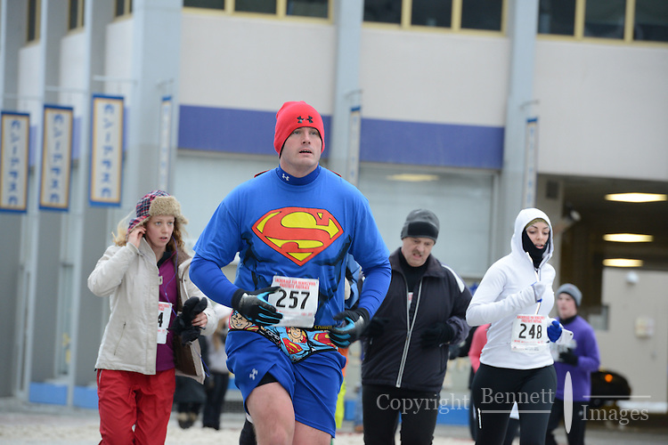Hundreds of people, some in costume and some not, take part in the annual Frostbite Footrace through downtown Anchorage, Alaska, as part of the 2013 Fur Rendezvous festival.