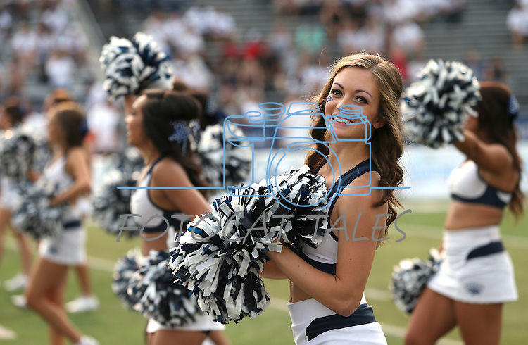 Nevada cheerleader Grace Whited cheers at an NCAA college football game against Arizona in Reno, Nev., on Saturday, Sept. 12, 2015.(AP Photo/Cathleen Allison)