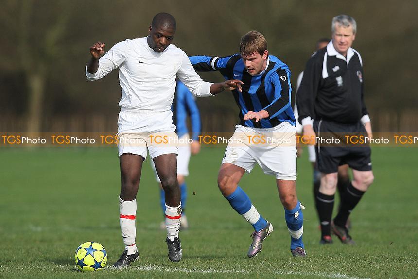 Inter Moore (blue/black stripes) vs Queensbridge Rangers (white) - East London Sunday League Football at South Marsh, Hackney Marshes - 27/02/11 - MANDATORY CREDIT: Gavin Ellis/TGSPHOTO - Self billing applies where appropriate - Tel: 0845 094 6026