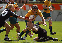 Tyler Stevens weaves between Kane Adams and Luke Whitelock during the International rugby match between New Zealand Secondary Schools and Suncorp Australia Secondary Schools at Yarrows Stadium, New Plymouth, New Zealand on Friday, 10 October 2008. Photo: Dave Lintott / lintottphoto.co.nz