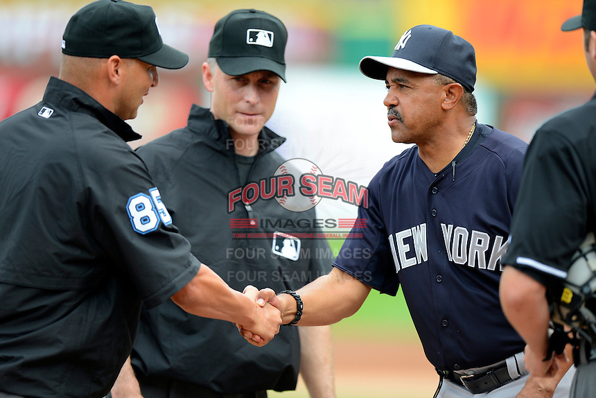 New York Yankees coach Tony Pena greets the umpires before a Spring Training game against the Philadelphia Phillies at Bright House Field on February 26, 2013 in Clearwater, Florida.  Philadelphia defeated New York 4-3.  (Mike Janes/Four Seam Images)