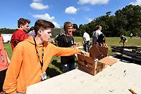 NWA Democrat-Gazette/FLIP PUTTHOFF <br />Students pick up spent shotgun shells   Sept. 12 2018 after their shooting session.