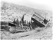 Wrecked stokc cars (#5839).  Seven men sitting on wrecked car.  3-4 men in background.<br /> D&amp;RG  Durango area - MP 466.70, CO  Taken by Payne, Andy M. - 1904