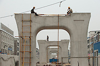 Daytime landscape view of construction workers sitting on a bridge structure in a Wuhan Metro Line Number Three construction site on Fa Zhan Da Dao near the Hankou Railway Station in Hànkǒu in the Jiānghàn Qū in Hubei Province.  © LAN