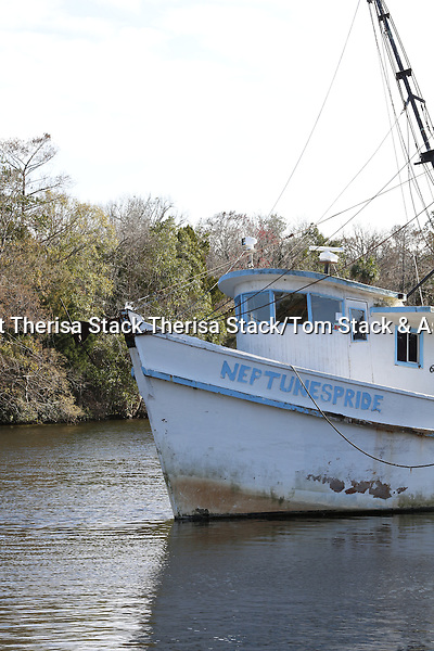 A vintage shrimp boat on the Withlacoochee River in Yanketeetown, Florida A vintage shrimp boat on the Withlacoochee River in Yankeetown, Florida