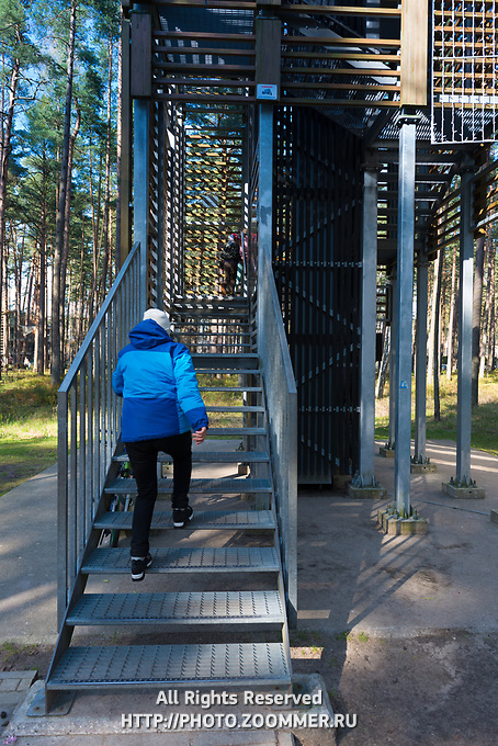Woman climbing the Dzintari tower in Dzintari park, Jurmala, Latvia