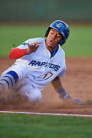 Romer Cuadrado (17) of the Ogden Raptors slides into third base during the game against the Great Falls Voyagers at Lindquist Field on August 16, 2017 in Ogden, Utah. The Voyagers defeated the Raptors 11-6. (Stephen Smith/Four Seam Images)