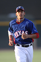Ronald Guzman #24 of the AZL Rangers before a game against the AZL Reds at Surprise Recreation Campus on July 24, 2012 in Surprise, Arizona. Rangers defeated Reds 3-1. (Larry Goren/Four Seam Images)