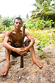 INDONESIA, Mentawai Islands, Kandui Surf Resort, portrait of young man holding a machete