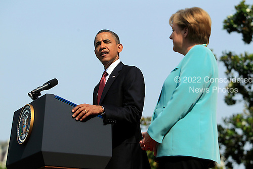 United States President Barack Obama, left, speaks during a welcoming ceremony for Angela Merkel, Germany's chancellor,right, on the South Lawn of the White House in Washington, D.C., U.S., on Tuesday, June 7, 2011. .Credit: Andrew Harrer / Pool via CNP