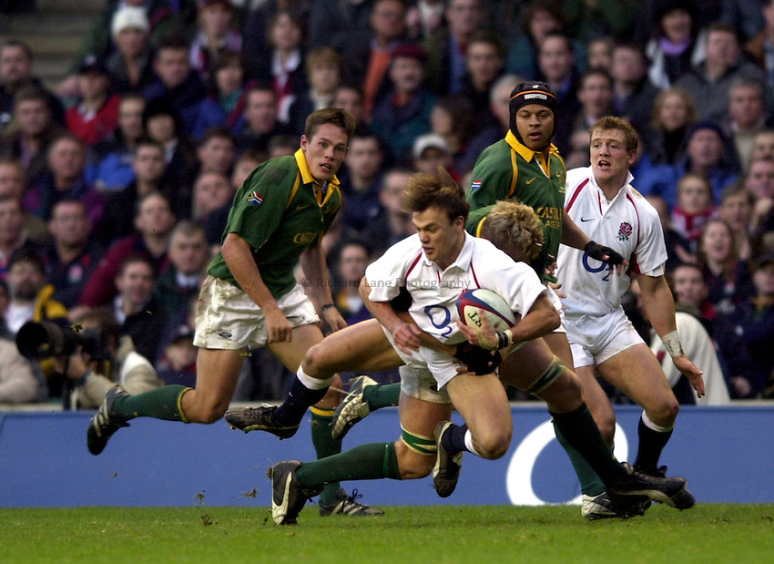 Photo: Richard Lane..England v South Africa. Investec Challenge at Twickenham. 23/11/2002..Phil Christophers is tackled.