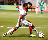 Javier Morales (r) of Real Salt Lake and James Riley (l) of D.C. United during the first half of the U.S. Open Cup Final on October 1, 2013 at Rio Tinto Stadium in Sandy, Utah.