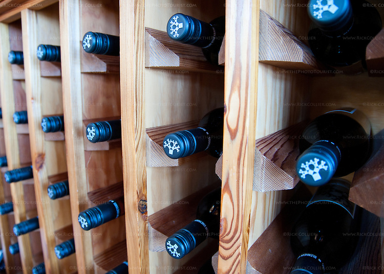 Bottles rest in neat rows in a display rack at Blenheim Vineyards.