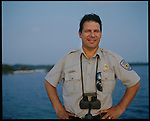 MARCH 2003 -- Pelican Island, Florida -- Audubon Magazine -- US FISH AND WILDLIFE OFFICER PAUL TRITIAK. Pelican Island Is the first wildlife refuge in the US, just celebrated it's centenial celebration.  President Teddy Roosvelt enacted the legislation for the island in the height of the Great Florida Bird Wars. Originally it was over five acres now just over two acres big. US Wildlife officers replenish the sandbars with Oyster shells. .