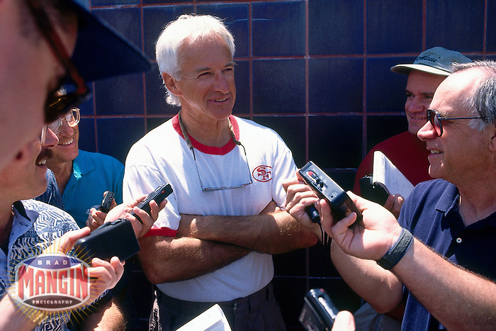 SANTA CLARA, CA - Head coach George Seifert of the San Francisco 49ers talks to the media after practice at the 49ers facility in Santa Clara, California in 1996. Photo by Brad Mangin