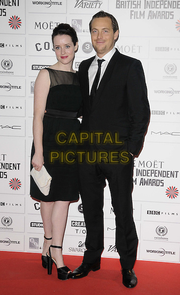 Claire Foy & Stephen Campbell Moore.The 14th Moet British Independent Film Awards 2011, Old Billingsgate, London, England..December 4th, 2011.full length black suit white shirt sheer dress sleeveless white clutch bag.CAP/CAN.©Can Nguyen/Capital Pictures.