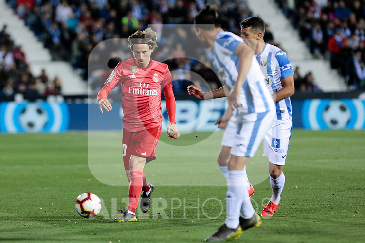 CD Leganes's Jonathan Cristian Silva and Real Madrid's Luka Modric during La Liga match between CD Leganes and Real Madrid at Butarque Stadium in Leganes, Spain. April 15, 2019. (ALTERPHOTOS/A. Perez Meca)