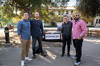 "From left, Tyler Melchisky '21, Dylan Sullivan '21, Nathan Graeser, Director of Veteran's Programs and Alexander Borges '21.<br /> The Occidental College Veterans Program hosts ""Hug-A-Vet"" in the Academic Quad on Nov. 11, 2019, Veterans Day. Students could stop by for snacks, hugs, high fives and conversation with Oxy veterans, who shared information about Oxy's military history and answered questions about their paths to college.<br /> (Photo by Marc Campos, Occidental College Photographer)"