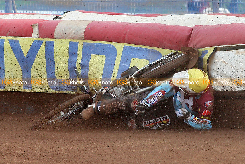 Heat 2: Stuart Robson (yellow) crashes out of the racing after tangling with Krzysztof Stojanowski - Swindon Robins vs Lakeside Hammers - Sky Sports Elite League Speedway at Abbey Stadium - 28/05/09 - MANDATORY CREDIT: Gavin Ellis/TGSPHOTO - Self billing applies where appropriate - 0845 094 6026 - contact@tgsphoto.co.uk - NO UNPAID USE.