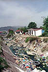 the river at the entrance of the Rom area full of rubbish. El Basan, Albania.