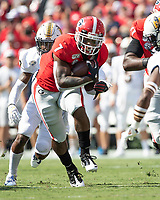 ATHENS, GA - SEPTEMBER 7: D'Andre Swift #7 runs through a hole during a game between Murray State Racers and University of Georgia Bulldogs at Sanford Stadium on September 7, 2019 in Athens, Georgia.